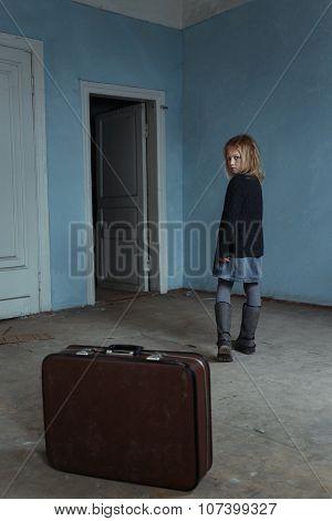 Miserable girl leaving the room