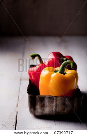 Bell peppers fresh on a wooden background