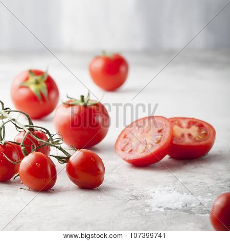 Fresh grape tomatoes, sea salt with a halved tomato