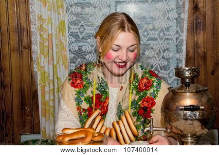 Woman In Traditional Scarf Drinking Tea.