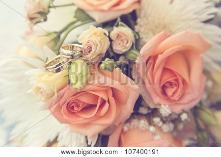 Wedding Rings On A Bouquet Of Rouses