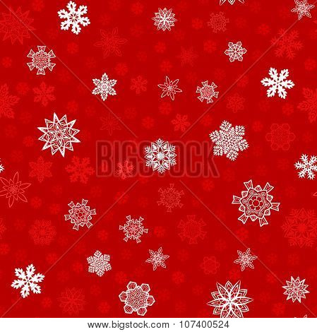 Seamless red winter background with white snowflakes