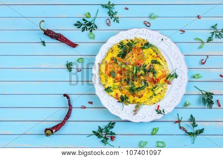 Omelette With Tomatoes, Chili On Plate Over Wooden Turquoise Background