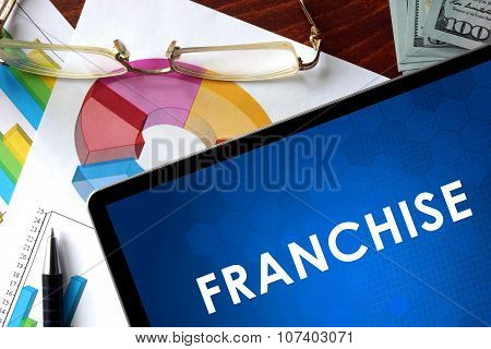 Tablet with franchise on a table.