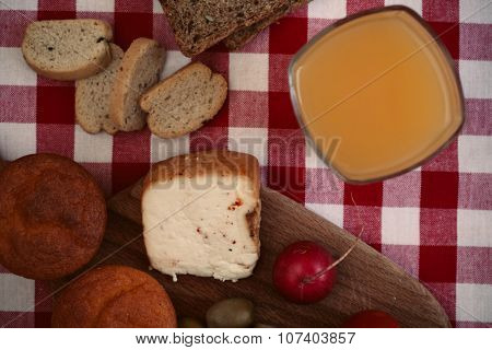 Breakfast with bread, radish, olives, cheese and juice. Shallow depth of field, vintage style.