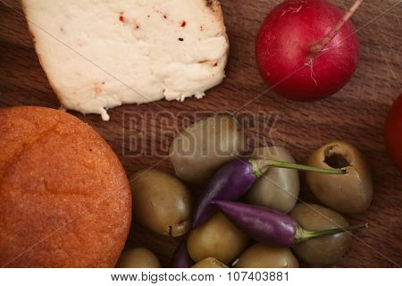 Breakfast with bread, radish, olives and cheese.