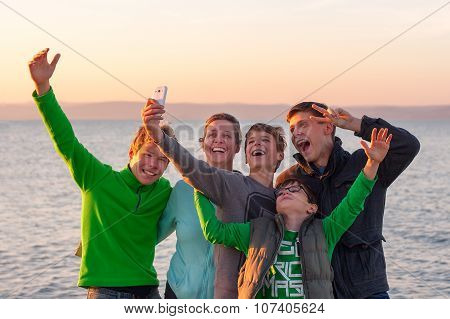 Group Of Young And Happy People Taking A Selfie At A Lake
