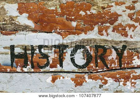 History written on old piece of wood