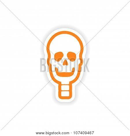 paper sticker on white background human skull