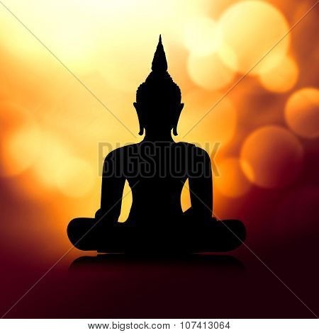 Buddha silhouette in lotus position - meditation concept