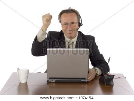 Successful Businessman At The Desk With Headset