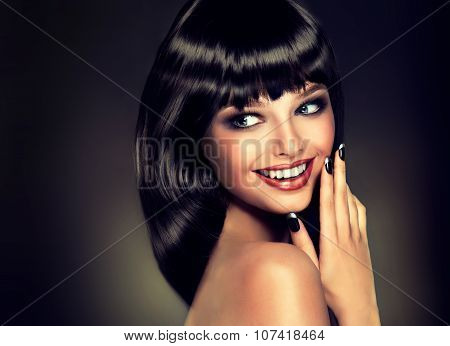 Surprised beautiful girl look away with a smile . Model brunette with shiny hairstyle.