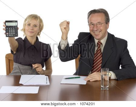 Business Meeting - Woman Displays Calculator