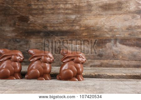 Chocolate Easter bunnies on wooden background