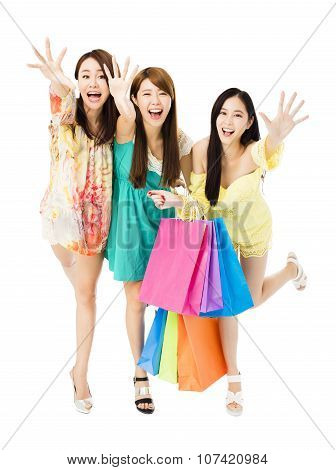 Young Woman Group  With Shopping Bags Running And Catching