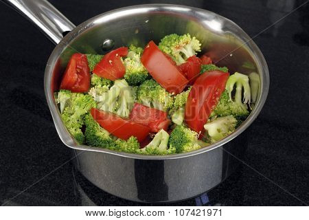 Raw Tomatoes And Broccoli In A Pan
