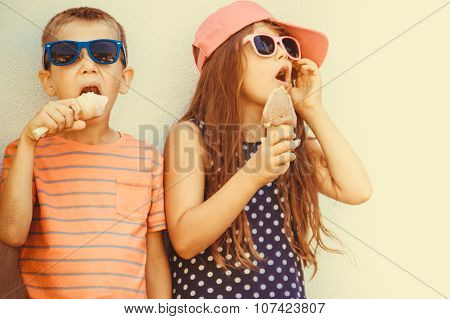Kids Boy And Little Girl Eating Ice Cream.