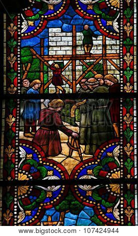 Stained Glass Of Construction Of A Gothic Cathedral In The Cathedral Of Leon, Spain