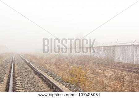 Railways at foggy weather morning