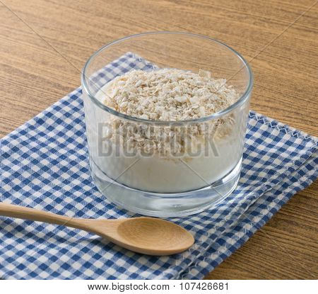 Homemade Yoghurt With Porridge Oats In Glass Cup