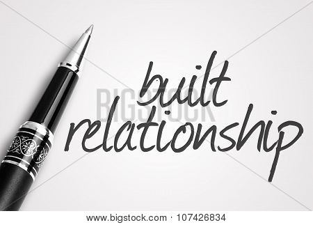 Pen Writes Built Relationship On White Blank Paper
