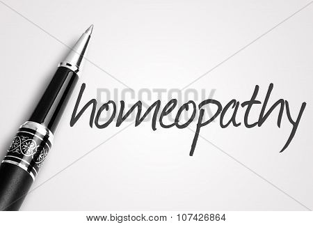 Pen Writes Homeopathy On White Blank Paper