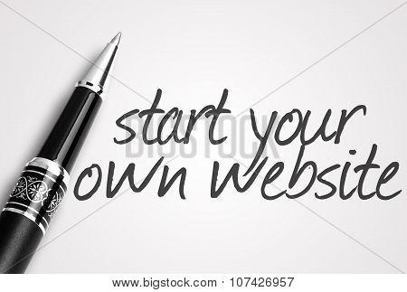 Pen Writes Start Your Own Website On White Blank Paper