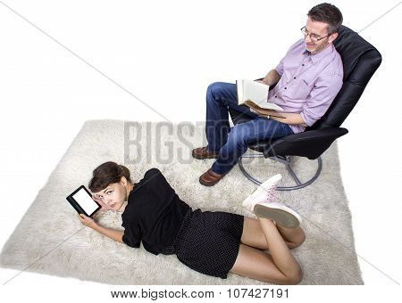 Family Reading a Book and Tablet