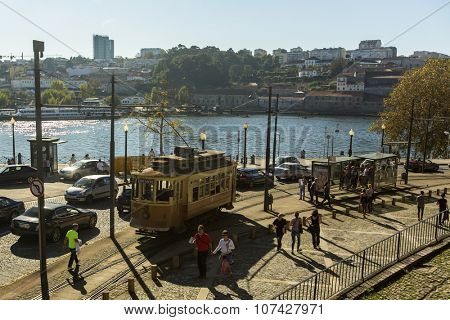PORTO, PORTUGAL - NOV 7, 2015: Heritage tram tourist line on the shores of the Douro. Construction its tram network started in Sep 12 1895, therefore being the first in the Iberian Peninsula.