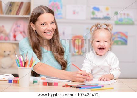 Cheerful woman is spending time with her child