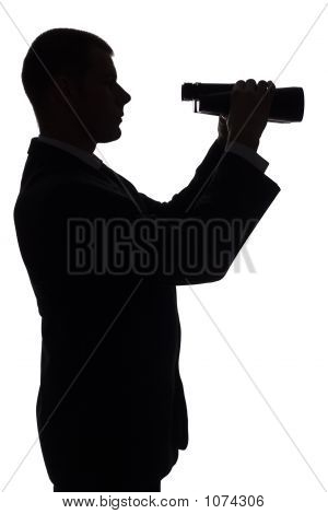 Silhouette Of Man With Binoculars