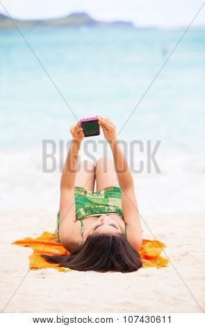 Biracial Teen Girl Arms Lying On Beach Relaxing By Ocean Water