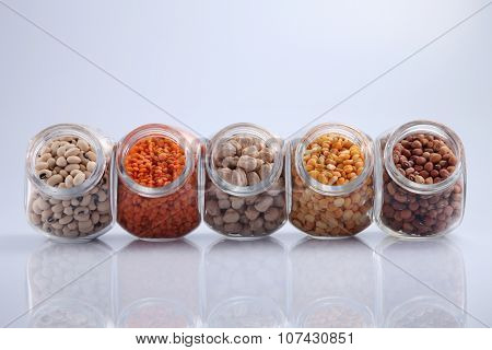 assorted beans in a galss container