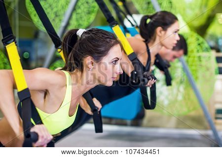 People at gym doing elastic rope exercises Concept sport workout fitness healthy lifestyle