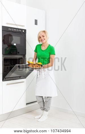 woman modern kitchen appliance setting