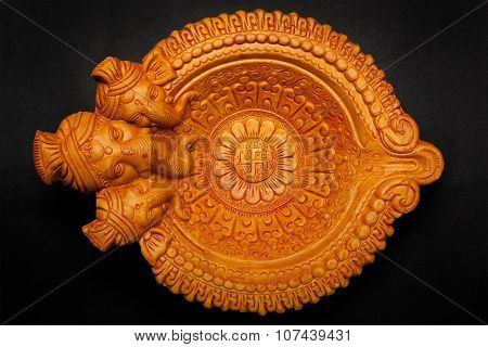 Top view of beautiful god face clay lamp.