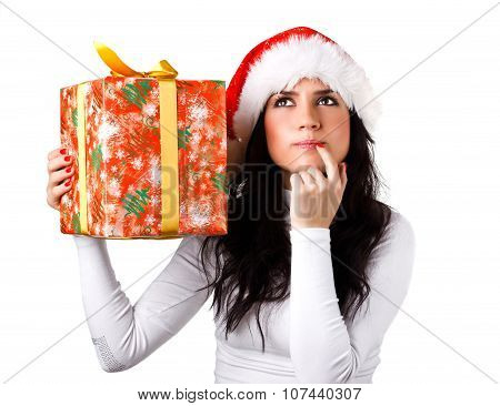 beautiful girl in the hat of Santa Claus with a gift