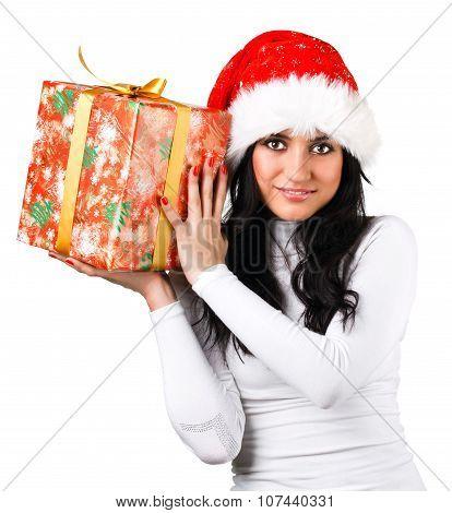 beautiful girl in the hat of Santa Claus