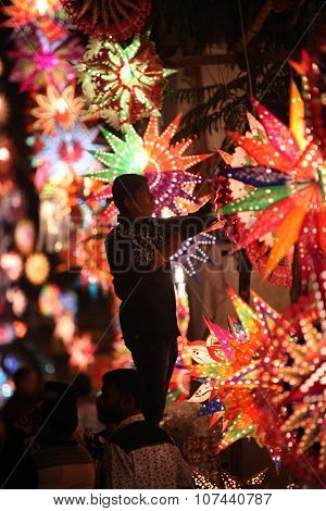 Pune, India - November 7, 2015: A Man Arranging Sky Lanterns In His Streetside Shop On The Occasion