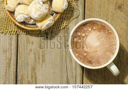 Hot Chocolate And Crescent Rolls Stuffed With Walnut And Powder Sugar On Wood