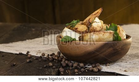 potato wedges in a wooden plate