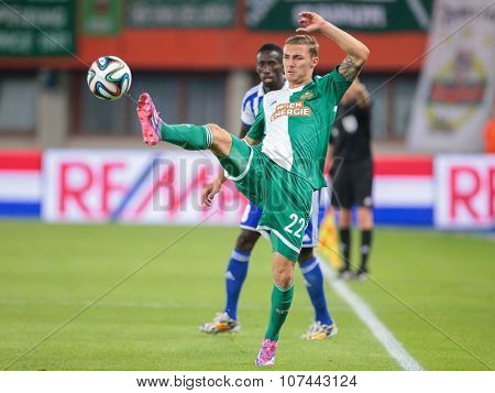VIENNA, AUSTRIA - AUGUST 28, 2014: Mario Pavelic (#22 Rapid) kicks the ball in an UEFA Europa League qualifying game.