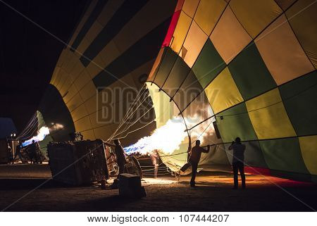 Hot Air Balloons Being Filled At Dawn