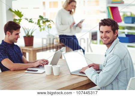 Creative businessteam working with mobile computers in casual office