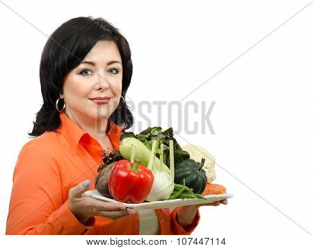 Portrait of nutrition consultant with a tray of fresh vegetables