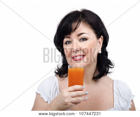 Woman with glass of homemade smoothie