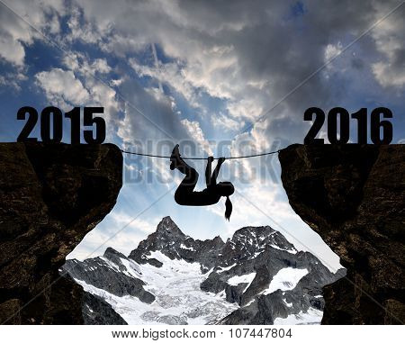 Girl climbs through the abyss into the New Year 2016.