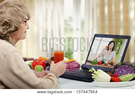Woman in wig prepared a vegetables smoothie