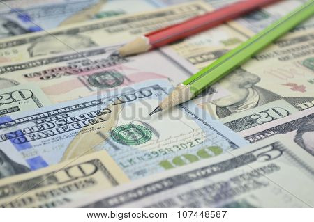 Pencil On Dollar Bank Note Money
