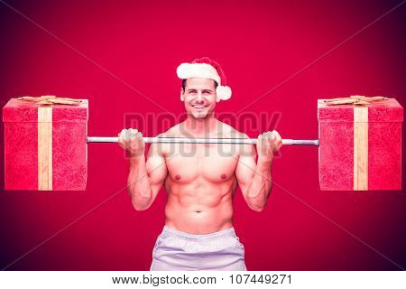 Handsome bodybuilder against red background